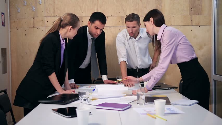 Business team having discussion at table in office | Shutterstock HD Video #22271956