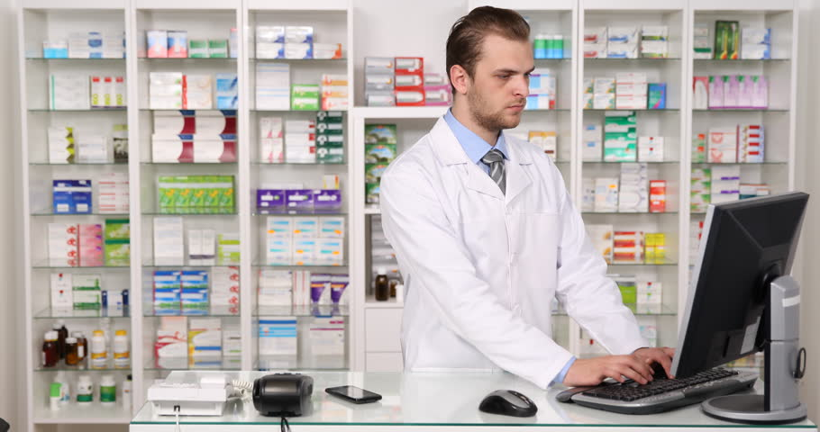 Young Pharmacist Specialist Man Talking Mobile Phone with Drug Company Pharmacy. Ultra High Definition, UltraHD, Ultra HD, UHD, 4K, 2160P, 4096x2160 | Shutterstock HD Video #22296556