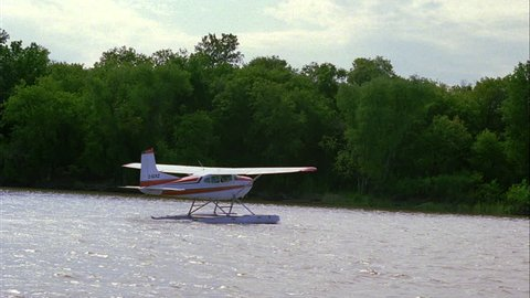 day View from hydroplane seaplane 2 taxiing hydro seaplanes river lake water, pushes one plane (Jan 2005)