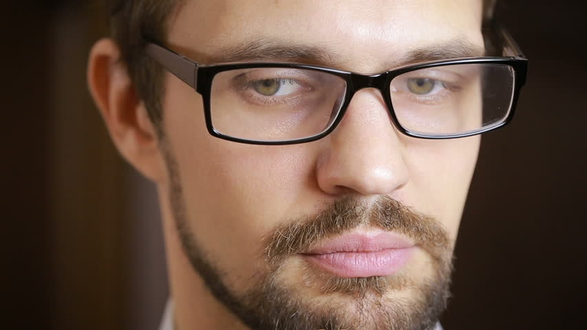 Close-up of beautiful green-eyed man with a beard wearing glasses | Shutterstock HD Video #22323055