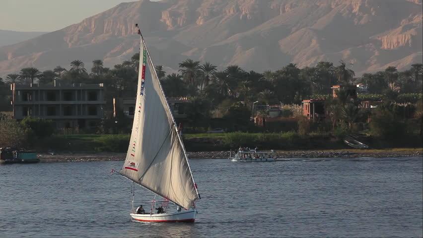 EGYPT, LUXOR - JANUARY 2013: Felucca & Passenger Ferries; River Nile Luxor Egypt