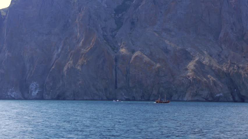 The ships sail on the sea near Kara-dag mountain