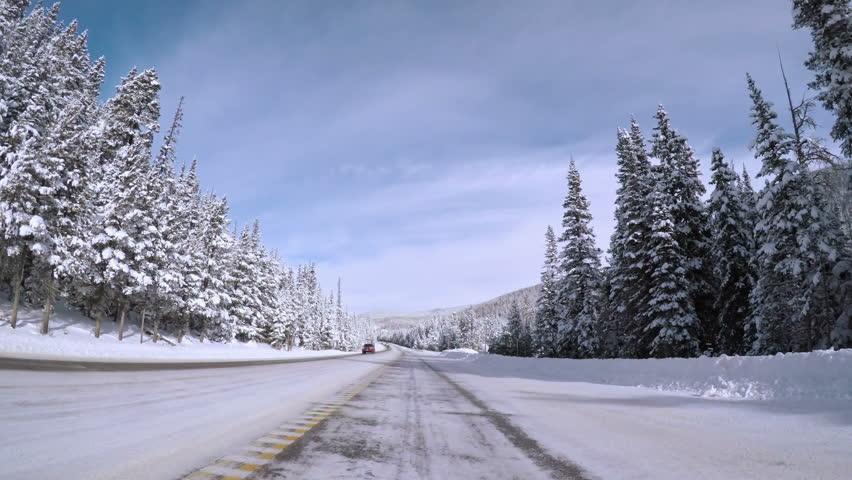 Denver, Colorado, USA-December 8, 2016. POV point of view - Driving through Berthoud pass after Winter storm.