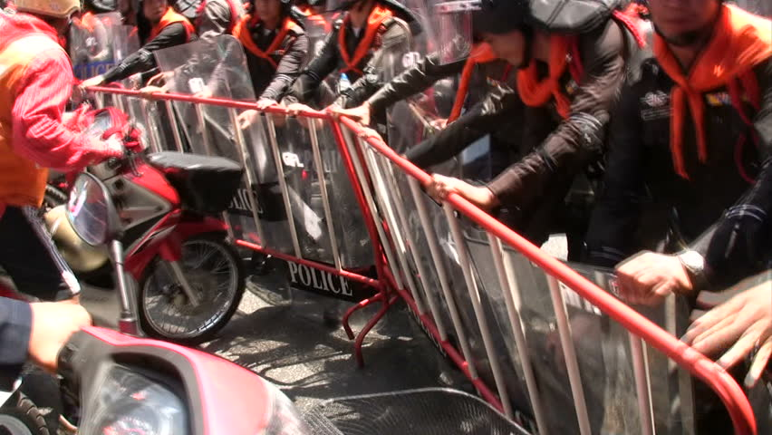 BANGKOK, THAILAND - MARCH 7: Red Shirt protesters face-off government troops in preliminaries to violence at Democracy Monument March , 2010 in Bangkok, Thailand