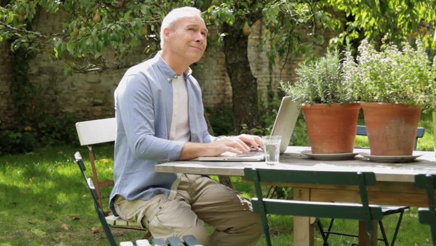 Mature Male At Table In Garden Working On Laptop Computer Stock Footage  Video 2247886 | Shutterstock