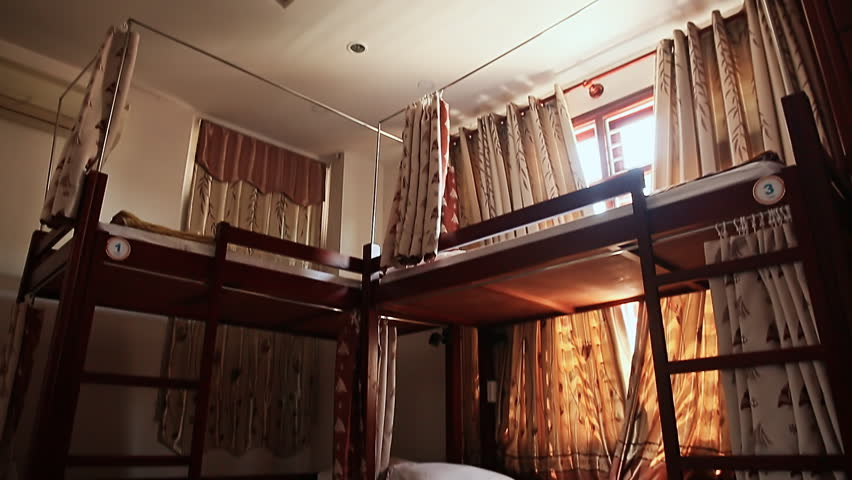 Hotel room with empty bunk beds in a small room of the Asian hostel in Vietnam.