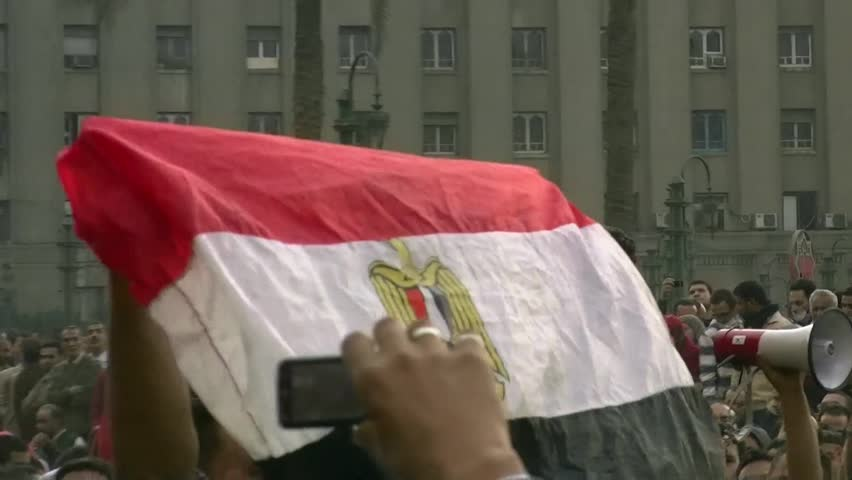 CAIRO - NOV 19: An Egyptian flag in the crowd in Tahrir Square on November 19, 2011 in Cairo, Egypt.