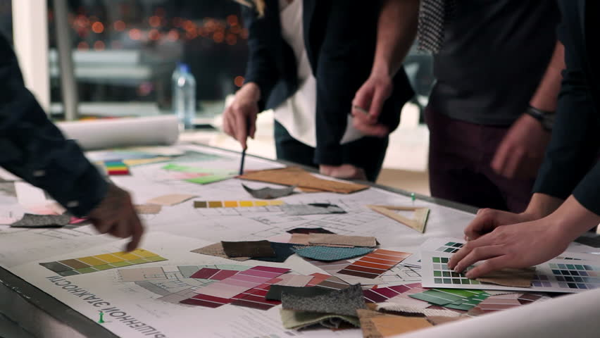 A group of young designers led by the head are working on the project of design business center, private home, studio, shop, office/Designers at Work | Shutterstock HD Video #22496833