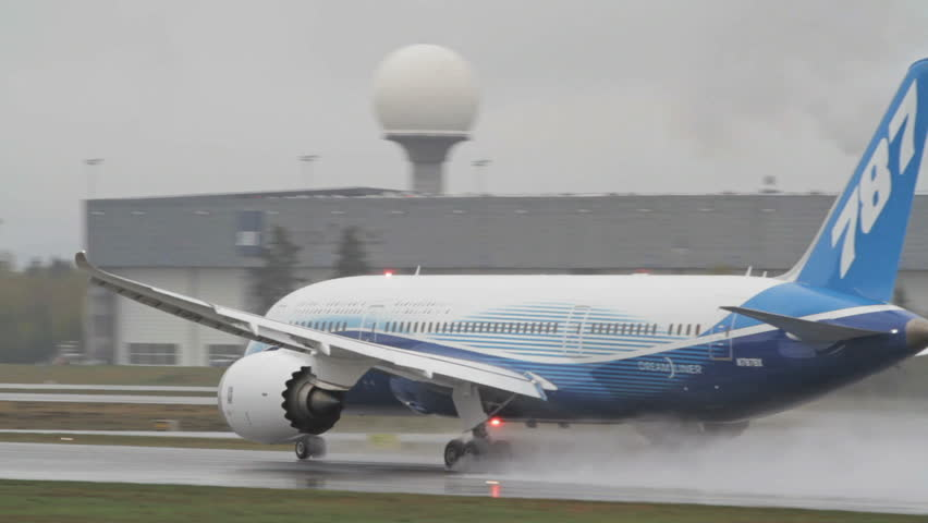 OSLO, NORWAY - MAY 4, 2012: Boeing 787 Dreamliner on its Europe Tour visiting OSL Airport, Oslo. Takeoff on its final day in very rainy conditions at runway 19L