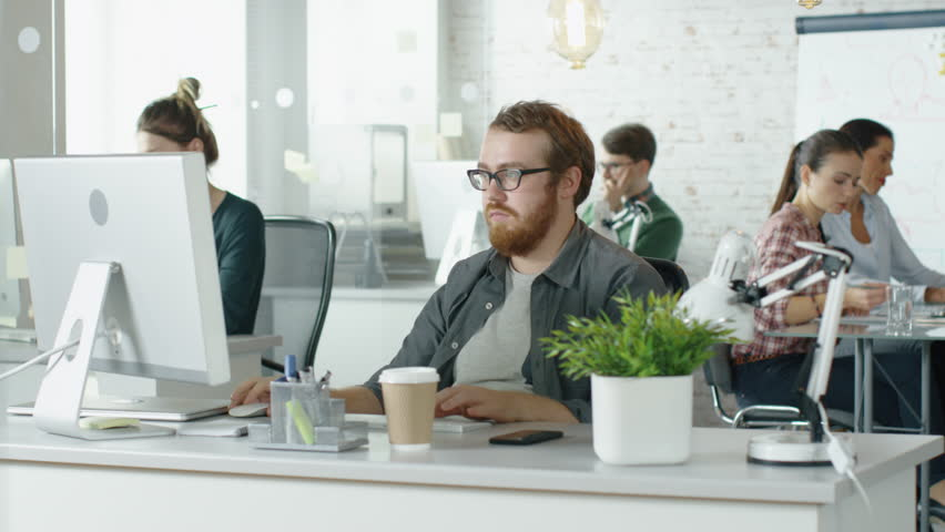 Weekday in a Busy Creative Bureau. Office People Working at Their Personal Computers. At The  Conference Table Business Discussion is Taking Place.Shot on RED EPIC (uhd). | Shutterstock HD Video #22521046