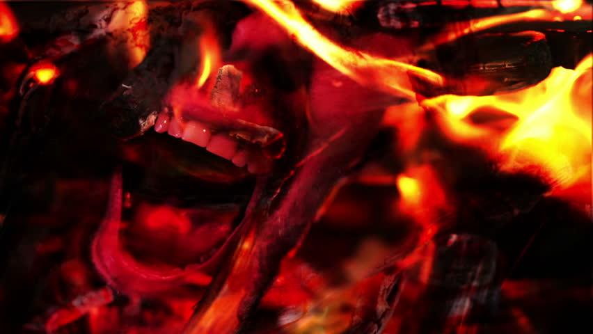 Demon face screaming in hell fire flames. Religious concept.