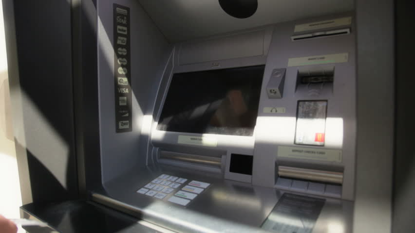Man getting money from ATM