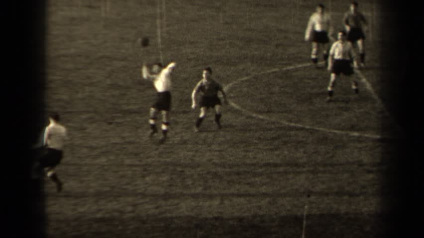 PARIS FRANCE 1947: black and white video of grown men playing a soccer game.
