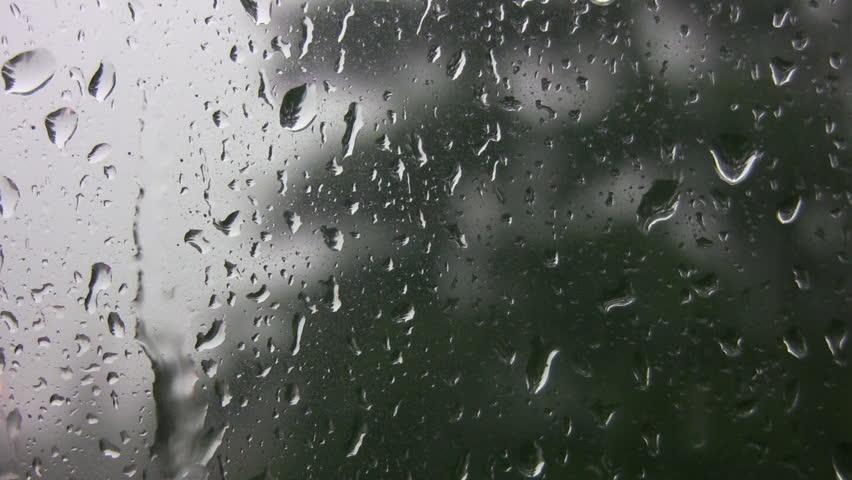 Rain running down window.