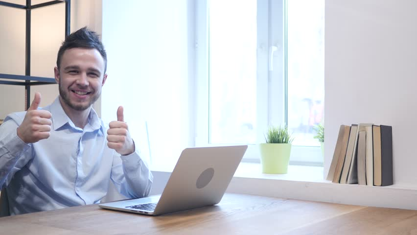 Thumbs Up by Young Man working on Laptop | Shutterstock HD Video #22674010