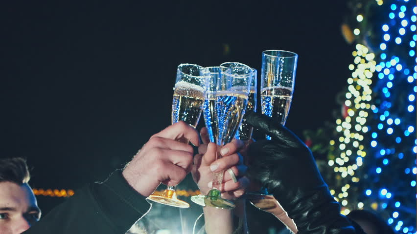 Four friends with champagne glasses celebrating