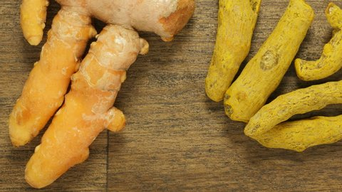 Fresh turmeric root, dried turmeric root and turmeric powder tracking shot