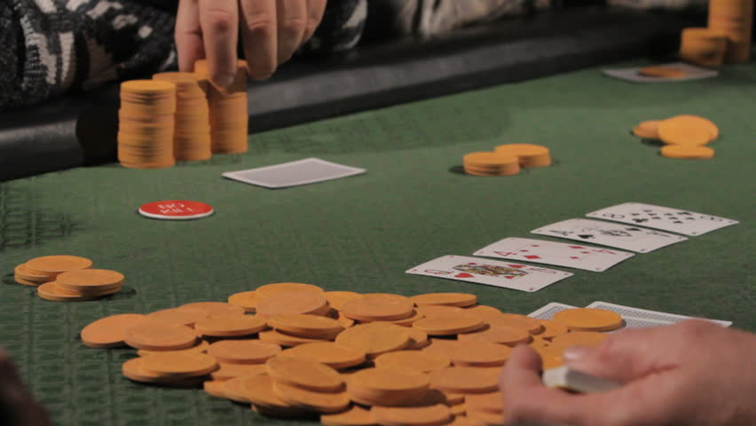Dealer pushing poker chips around the table | Shutterstock HD Video #2278586