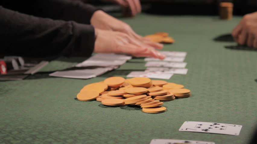 View of a poker table with chips and cards being used | Shutterstock HD Video #2278706