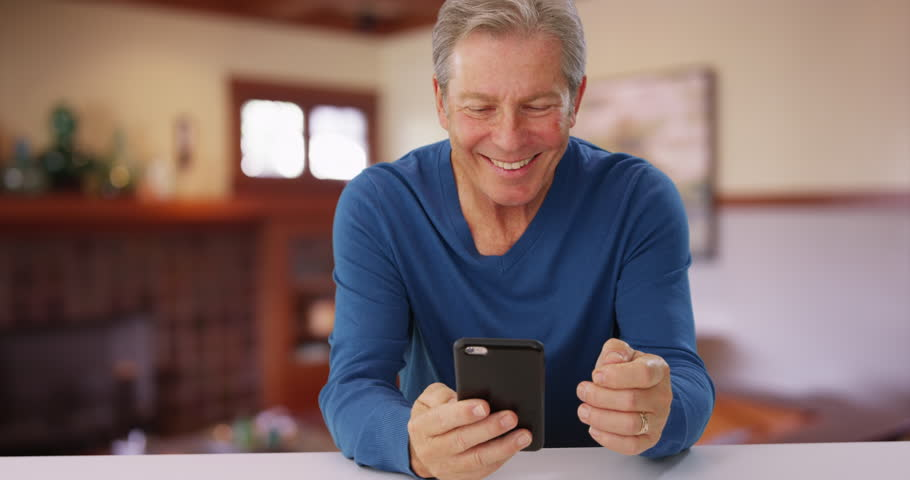 Handsome mid aged man making phone call with cellphone. Mature elderly man using smartphone to answer phone call. | Shutterstock HD Video #22797760