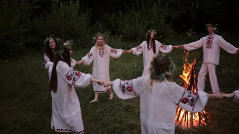 Midsummer. Young people in Slavic clothes revolve around a fire in the Midsummer.