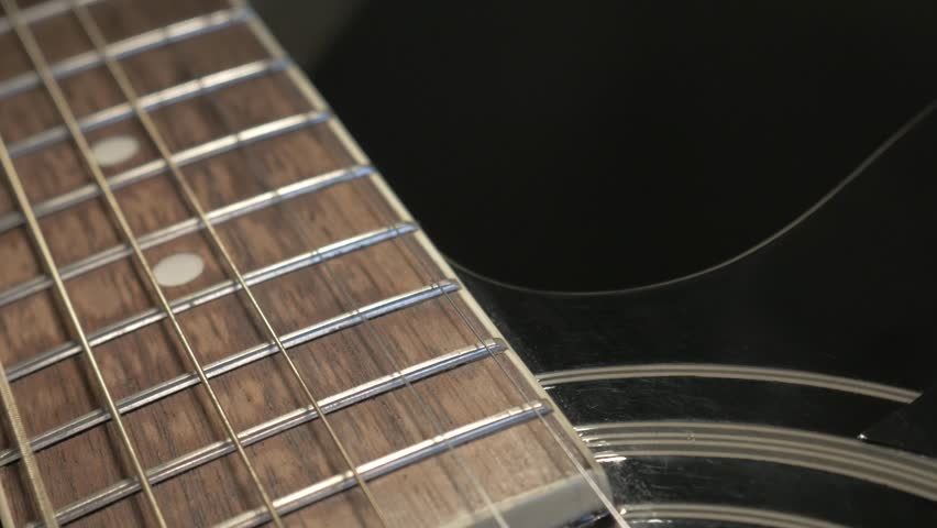 Neck of an acoustic guitar