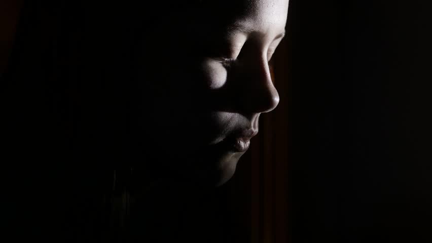 4 Scared by something teen girl in the dark. 4K UHD.