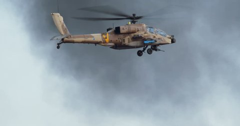 Israeli air force Apache helicopter firing 30mm canon during attack