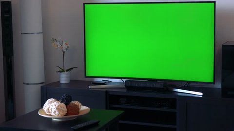 A TV with a green screen - living room - closeup