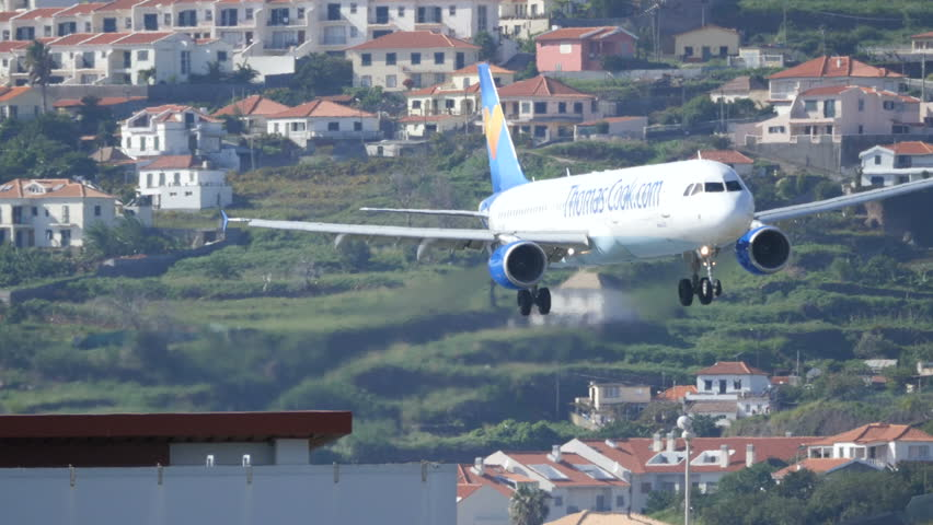 Airbus A 321 OY-VKT of Thomas Cook Airlines Approach Madeira Airport. Madeira Airport (Funchal, FNC, LPMA) is the civil international airport of the Portuguese island of Madeira.