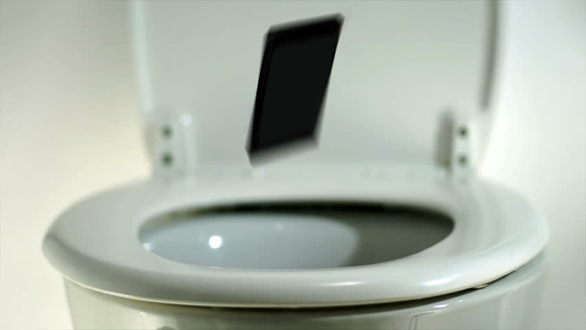 Phone falling into a toilet bowl. Smart or mobile or cell phone making a splash as it lands in a toilet.