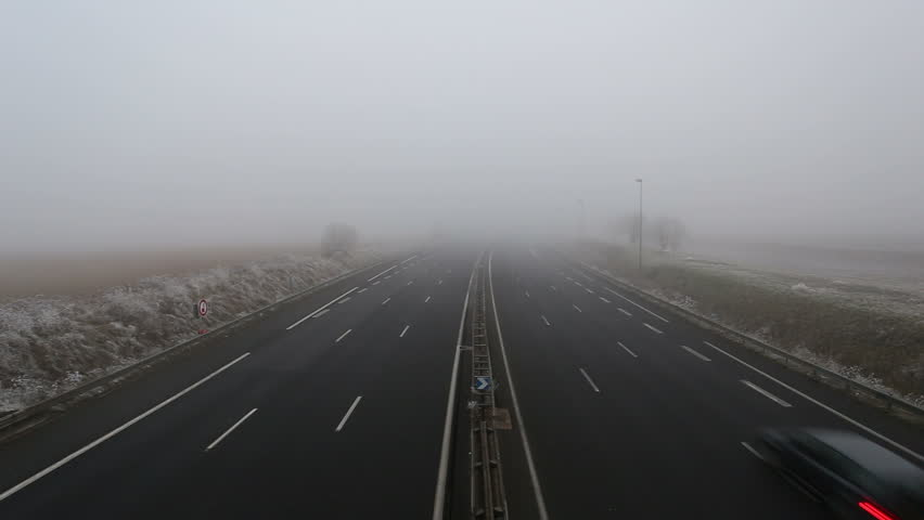 Elevated view of traffic on A10 autoroute in fog near Tours France