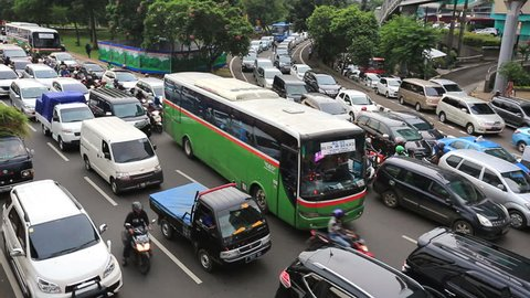 An high angle view of a traffic jam in the crowded streets of Jakarta South Central Business District along the Gatot Subroto highway in Indonesia capital city at day.