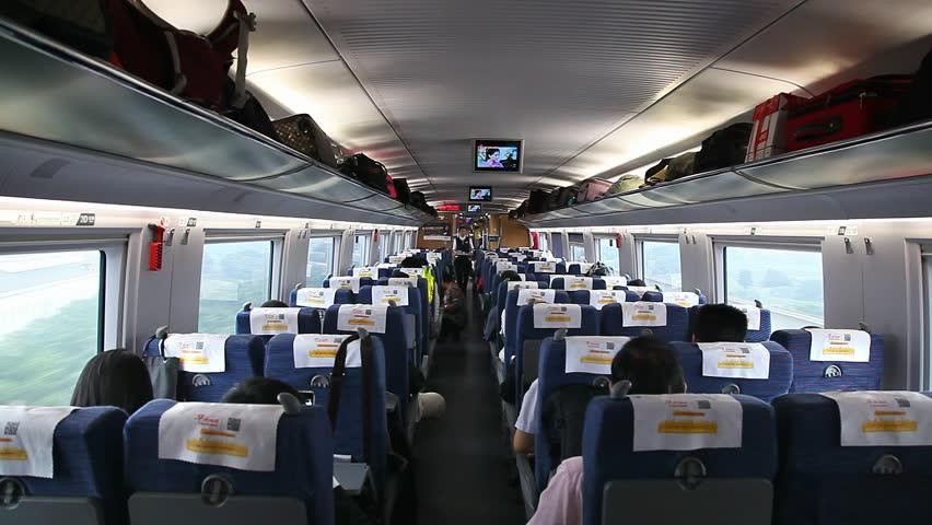 BEIJING, CHINA - SEPTEMBER 27, 2014: Passengers inside of a bullet train on September 27, 2014 in Beijing, China | Shutterstock HD Video #22971571