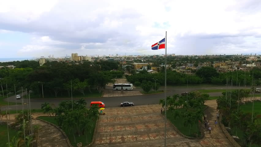 The camera slowly flies past a waving flag of the Dominican Republic