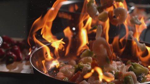 Stir fry into flaming pan in super slow motion, shot on Phantom Flex 4K