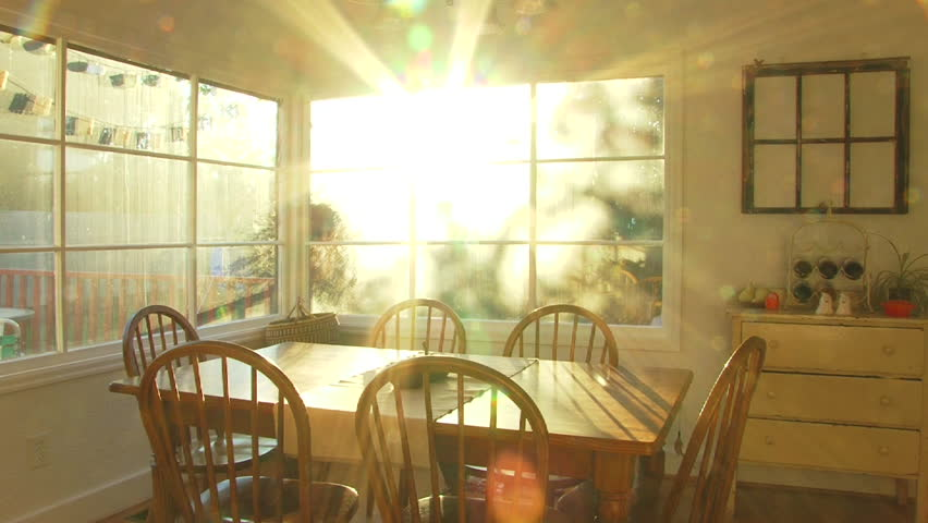 bright sunset shines through window of dining room at house time lapse - Home Time Furniture