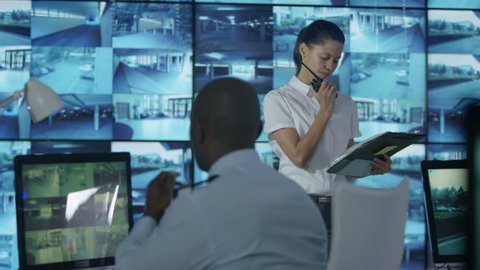 4K Time lapse busy security staff watching the screens in observation control ro Dec 2016-UK