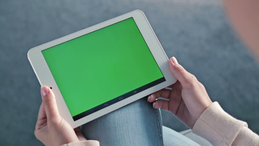 Woman looking at tablet with green screen. Close up shot of woman's hands with pad   Shutterstock HD Video #23086048