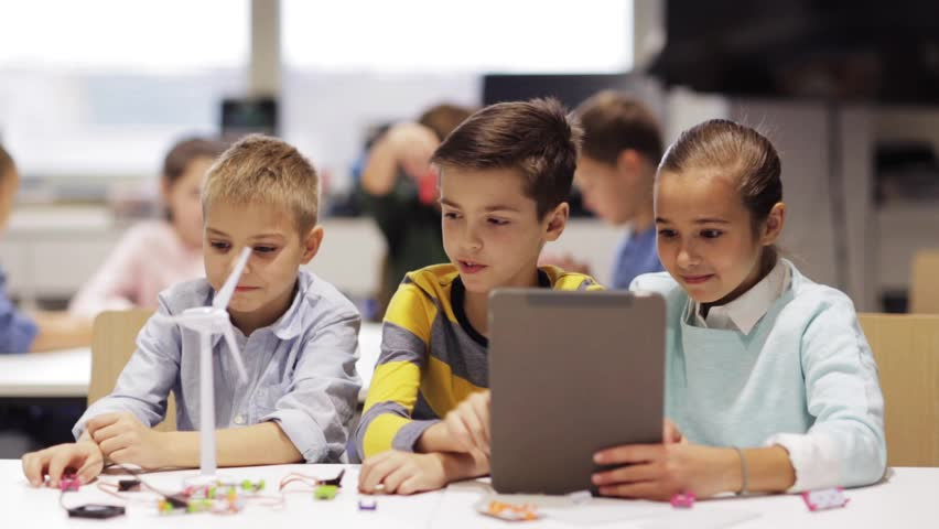 Education, science, technology, children and people concept - group of smiling kids or students with tablet pc computer programming electric windmill toy at robotics school lesson | Shutterstock HD Video #23119246