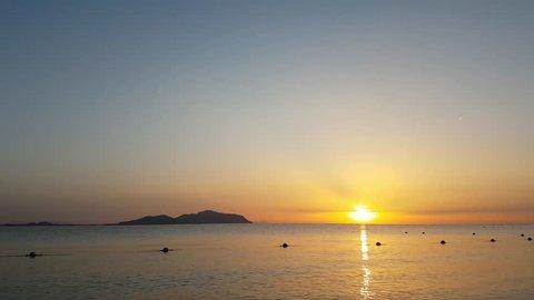 Egypt, Red Sea, South Sinai, Sharm El Sheikh, Sharks Bay lagoon, Beach in Egypt. Morning time sunrise panoramic view of the Resort Red Sea Coast beach. Tiran Island view. Timelapse.
