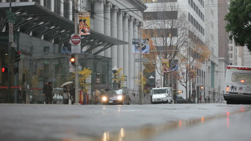 Downtown San Francisco on a rainy day in 2009. Pedestrians walking in a crosswalk on a rainy day in San Francisco, California.