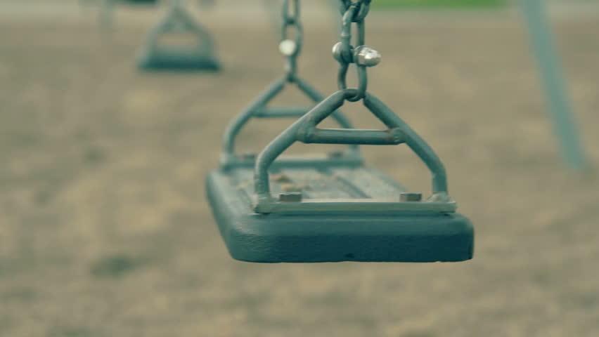 Swing swaying in a empty park.