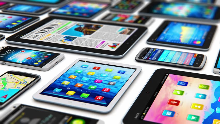 Group of tablet computer PC and modern touchscreen smartphones or mobile phones with various internet applications and web apps with color interface and colorful icons and buttons with selective focus