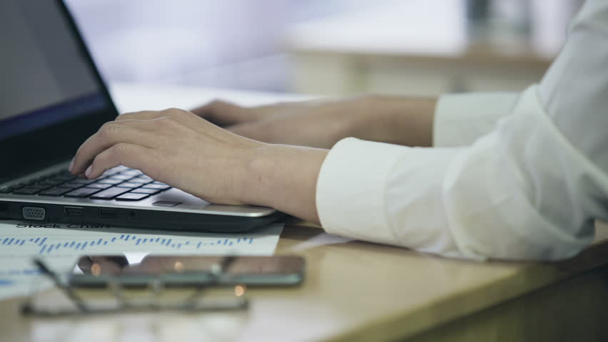 Female hands typing text on laptop, busy office employee working on project | Shutterstock HD Video #23154358