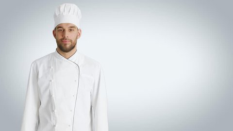 Mid Shot of a Handsome Chef Crossing Arms and Smiling. Shot with White Background. Shot on RED Cinema Camera in 4K (UHD).