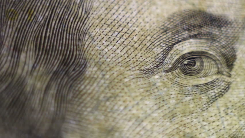 Tracking macro of Benjamine Franklin's face on the US one hundreed dollar bill. US dollars background.  | Shutterstock HD Video #23214913