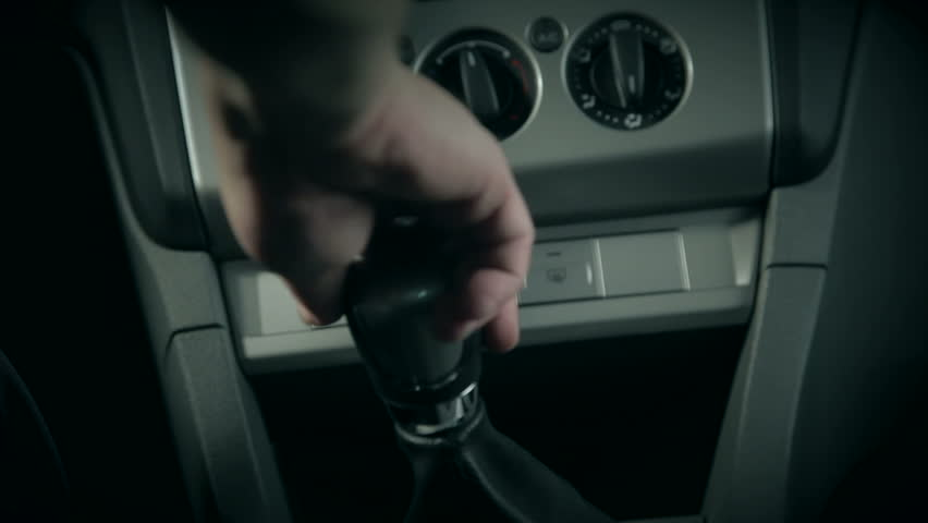 multiple shots of a man driving a car, shifting through gears in 1080p