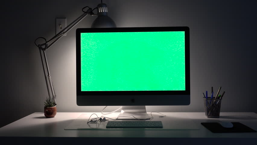big beautiful computer with a lamp on a green background