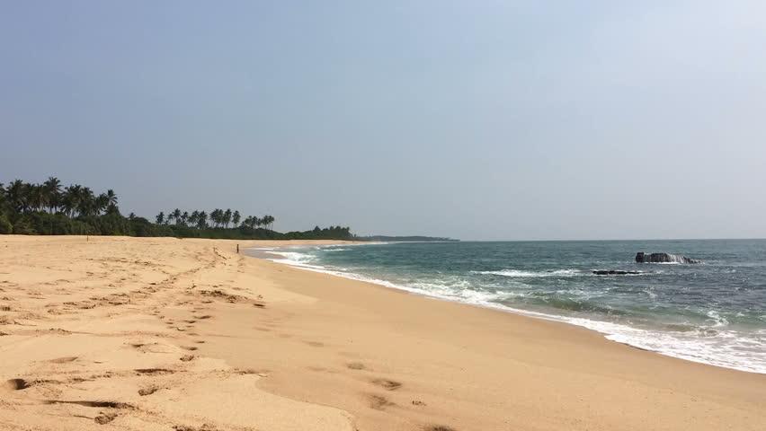 sand and ocean waves and coconut palms on paradise beach Rekawa Sri Lanka #23292796
